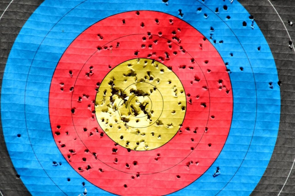 target with arrow holes
